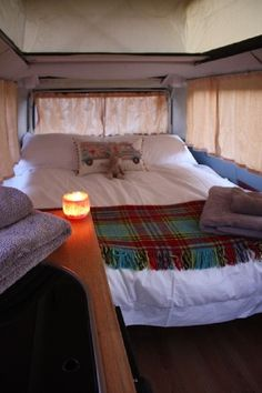 I know a van doesn't have a raised roof, but I like this idea regardless.                                                                                                                                                                                 More