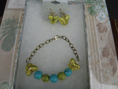 Set includes:  turquoise and lime green beads by Varietyofitems