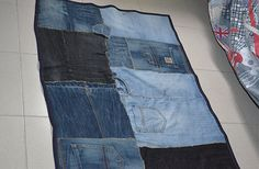 Bedroom rug made out of old jeans.