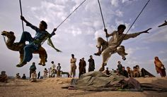Bajur, Pakistan: Children who fled their villages due to fighting between security forces and militants enjoy a ride on a merry-go-round at a makeshift entertainment park Picture Blog, Picture Editor, Big Picture, Poses For Pictures, Pictures Of The Week, Ashley Jackson, Korean Student, Pure Happiness, Kids Laughing