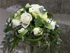 Extravagant round bridal #bouquet of mixed white flowers and cascading foliage by Renne-Fleuriste.