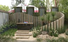 Achievable Gardens at MIFGS 2013 | GardenDrum 'Coastal Wave' Design Rohan Thorn Holmesglen TAFE What a beautiful double wall, with waves of bleached grey timber creating great space-stretching layering. It was hard to believe that this garden was exactly the same size as the others and it's a good example of how leaving a central area open does not make a tiny area look bigger
