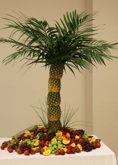 Pineapple tree. Very easy to make. I used a christmas tree stand and pvc pipie for the center. I placed brown sugar at the base of the tree to make sand. Very easy.