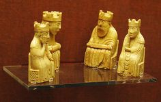 Four of the Lewis Chessmen (Uig Chessmen). There are 78 in all carved in Walrus Ivory dating to the 12th century. The chessmen were discovered in early 1831 in a sand bank at the head of Camas Uig on the west coast of the Isle of Lewis, in the Outer Hebrides and are now on display in the Royal Museum in Edinburgh and the British Museum in London.