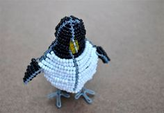 Beaded Penguin African craft Wire Sculpture by akwaabaAfrica, $15.00 Wondering how a penguin can be African?  Actually, only a few miles from our home, here on the Cape peninsula, at Boulders beach, a colony of African penguins play in the hot summer sun. African Penguin, Boulder Beach, African Crafts, Beads And Wire, Wire Art, Summer Sun, Penguins, Cape, Sculpture