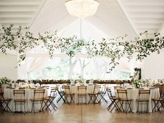 If you're the kind of bride who dreams of lush, organic florals, or of an utterly romantic gown to take your groom's breath away...this wedding is for you. Set it Kyle, Texas, it's an outdoor affair designed by Westcott Weddings and captured by Michelle