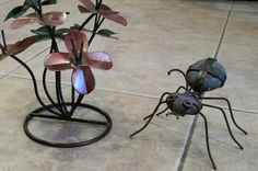 Metal garden flowers & garden ant made out of metal and stones