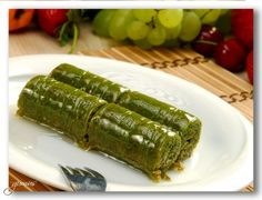 fistik sarma (a kind of dessert made with pistachio and syrup, delicious! Lebanese Recipes, Turkish Recipes, Delicious Deserts, Yummy Food, Kunafa Recipe, Turkish Baklava, Kinds Of Desserts, Middle Eastern Recipes, Food Dishes