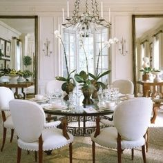 fABULOUS MIRRORS - in this dining room with a round table and Greek key base - wonderful oval back arm chairs too!                                                                                                                                                                                 More