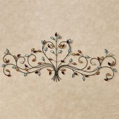 Wispy scrolls surround the heart featured on the Jeweled Love Wall Grille. Openwork metal wall grille has a bronze finish and is accented with ceramic jewels.