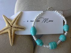 Bracciale celeste e bianco con perle di carta  eco di Acasaconmanu