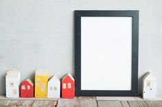blank poster frame on table by ptystockphoto on @creativemarket
