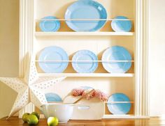 this is how to build a plate rack, but what stands out to me is the lovely blue plates....beautiful!