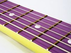 It's customary for fretted western instruments to have 24 frets and two octaves.