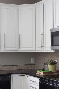 Oak cabinets painted white, im doing this in our new house!