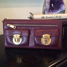 ✨HP✨Marc Jacobs Burgundy Zip Clutch Wallet 🌟HP x 2🌟 Marc Jacobs Wallet, very gently used.  Quality Italian leather with goldtone hardware.   Four inner pockets, six card holders and a total of four outer pockets. Can be used as a small clutch as well. Some use can be seen on the gold hardware (see photos) and a teeny bit of wear on the leather. A classic Marc Jacobs piece. Marc Jacobs Accessories