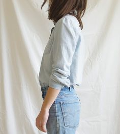 Washed out, super light colored, denim button down and light colored Levi's.