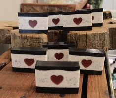 Layered Shea bar made with activated charcoal. Tart, but light blend of pomegranate and cranberry, enlivened by blood orange citrus and grapefruit and intertwined with juicy black currant notes. Light hints of fig, soft floral and leafy greens add depth. The poppy seeds add a subtle amount of scrub, leaving the skin feeling smooth. Black Currants, Activated Charcoal, Blood Orange, Apothecary, Pomegranate, Grapefruit, Soaps, Fig, Poppies