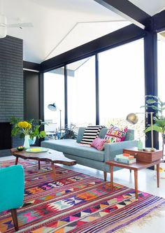 graphic and colorful mid century modern living room with blue sofa