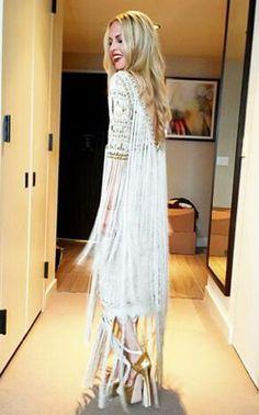 Rachel Zoe in white fringed bohemian dress and gold platform heels