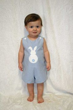 Our boys Easter jon in blue gingham check has a cute Easter bunny appliqué on the front. Embroidered name is included in price. We are happy to change fabric color, font choice and thread color Can be