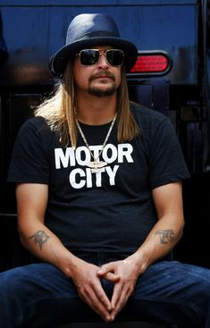 Kid Rock Photos Photos - Recording Artist Kid Rock takes part in pre-race ceremonies for the NASCAR Sprint Cup Series 57th Annual Daytona 500 at Daytona International Speedway on February 22, 2015 in Daytona Beach, Florida. - 57th Annual Daytona 500