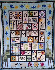 Looking for quilting project inspiration? Check out The Quilt Show 2015 BOM done QAYG by member beallen, Quilting Big Projects on a Small Machine on Craftsy.