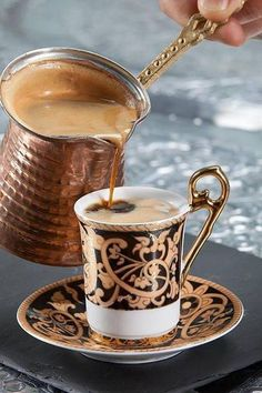 This is Turkish coffee, It is literally a part of the life of almost every Jordanian or Palestinian, or for that matter, any Middle Eastern on this planet! It is spiced with cardamom and brewed on low heat to create that light brown colored foam. In our cutlure, you almost always welcome your guests with a cup of coffee, and as it's time for them to leave.. You always end up with a finjan as well!