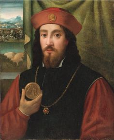 """ATTRIBUTED TO BARTOLOMEO VENETO, BETWEEN, PORTRAIT OF A MAN HOLDING A MEDAL, 14 3/4 X 11 1/2""""."""