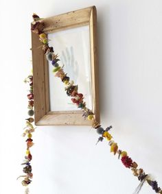 """An impressive-looking dried garland from Brooklyn stylist Shane Powers calls for buds and petals collected from several sources. """"You want a huge variety of color; it just looks better,"""" says Powers. For his how-to tips, seeDIY: Dried Flower Garland with Shane Powers."""