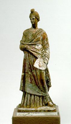 In the picture: �anagra figurine. Terracotta representing a female figure. Boiotia, c. 325-300 B.C.