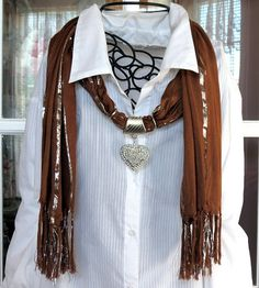 Elegant scarf is a solid brown with silver threads. The pendant is a silver plated metal alloy see through puff heart. Scarf is 70 inches long out of a soft material.