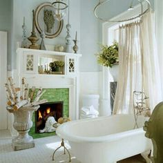 Bathroom with a fireplace and a view
