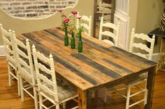 Harvest-style dining table made from shipping pallets.