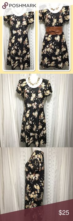 "90s vintage black& flower shift dress size 13-14 90s shift dress lightweight fabric, feels a little stiff like it's never been washed. Beautiful natural colored rose print. Round neck with short sleeves. Shoulders 16 inches Chest 21 inches Length 36"" 100% rayon By All That Jazz  Made in the USA Wear dress loose and flowy or add to a belt for a more fitted look. Thanks for visiting my closet, feel free to look around!🤗 Vintage All That Jazz Dresses"