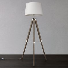 The charming coastal inspired wood tripod floor lamp is complete with chrome metal detailing.