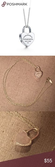 Tiffany & Co Heart Lock Necklace Front: Please Return to Tiffany & Co. New York 925. Back: Tiffany & Co. 925. Sterling silver. 18 inch chain Tiffany & Co. Jewelry Necklaces