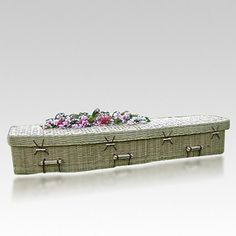 The Repose Bamboo Green Casket V is hand woven from sustainably-raised bamboo grown on licensed farms and lined with pure, soft cotton fabric. This biodegradable casket is made from 100% natural materials, no glues or metal fasteners, making it perfect for cremation or a green burial. Green burials are becoming more popular, they are seen as a way to give a person back to the earth in a natural and dignified way.  Color variations are normal in natural caskets.