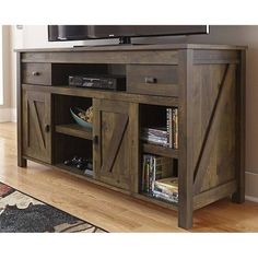 "Gracie Oaks Cleveland 60"" TV Stand Color: Brown The bottom shelf opening center dimensions are 8.3'' H x 26.8 W x 17.4'' D. The top shelf opening center dimensions are 8.3'' H x 26.8 W x 16.6'' D."