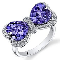 Peora 14K White Gold Heart Simulated Alexandrite Diamond Ring (6.95 cttw) Peora http://www.amazon.com/dp/B00BURWX2A/ref=cm_sw_r_pi_dp_BGJOvb1X7C31S