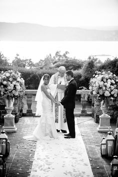 Lakeside ceremony at Tappan Hill Mansion. Floral: Diana Gould Ltd. Photography: Tory Williams - torywilliams.com