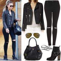 Perrie Edwards was spotted leaving the studio a few days ago wearing an AllSaints Tassel Leather Biker Jacket ($595.00), the Topshop Moto Black Ripped Jamie Jeans ($75.00), a Prada Daino Convertible Satchel (Sold Out), the Ray-Ban Aviator Classic Sunglasses ($200.00) and a pair of AllSaints Aiden Jules Boots ($415.00).