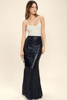 Lulus Exclusive! The Effervescent Evening Navy Blue Sequin Maxi Skirt is sure to show off your bubbly personality! Woven poly is decorated with a sea of sparkling sequins that bedazzle from the high, fitted waist, down to the flaring maxi hem. Hidden zipper/clasp at back.