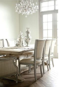 I want this dining set....I have a new obsession with nailhead trim