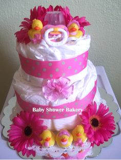 These cute baby girl duckies make this diaper cake the perfect way to welcome your baby girl into the world! It will make a great baby shower centerpiece or gift to take to the hospital! $35 @Etsy #diaper #cake #baby #shower
