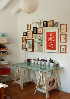 Well Ordered Space: trestle table is a double act at storage plus love the frames above desk.