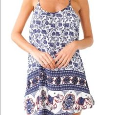 Dress tribal print Thin strap tribal print dress. Looks like sabo skirt. Not tight fit with partly open back Sabo Skirt Dresses