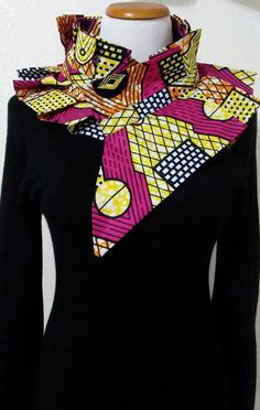 Beautiful African Print Neck collar. This elegant Neck Collar is perfect accessory to add a splash of color to any of your favorite tank top, sleeveless dress, collared shirt and more.