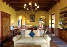 Casa Heyne living room. CASA HEYNE is a colonial hacienda style home built in 2000 of adobe in the Lavanderia area of San Miguel. Local workmen, woodworkers, stonemasons, iron workers and decorative painters handcrafted this 18,000 sq. foot plus home. Set on a hillside on the edge of the Historical district on a rock wall amid bougainvilleas and extensive gardens, it is only a 12-minute walk to the Jardin.