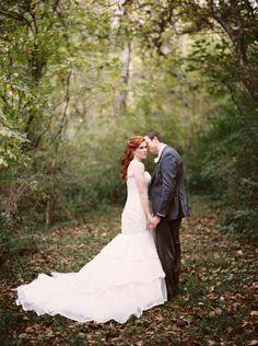 October wedding in Knoxville, TN. Redheaded bride in ivory mermaid dress by Essense of Australia.